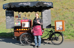 Woman in front of Coffee-Bike cart