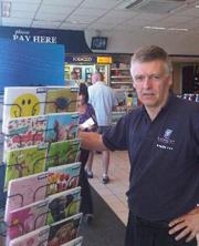Brian Spilman beside greetings cards